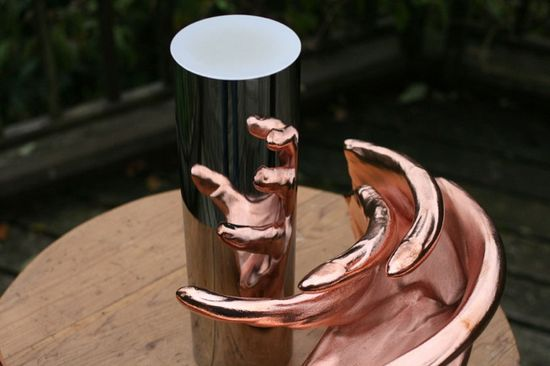 London-based artist Jonty Hurwitz creates 'Anamorphic Sculptures' which only reveal themselves once facing a reflective cylinder.