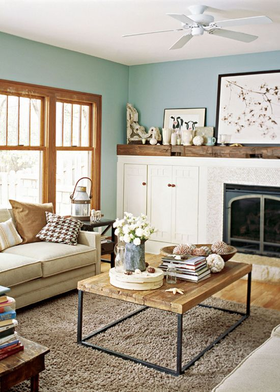 Love the table, the print of cows on the mantle, and the wood window frames