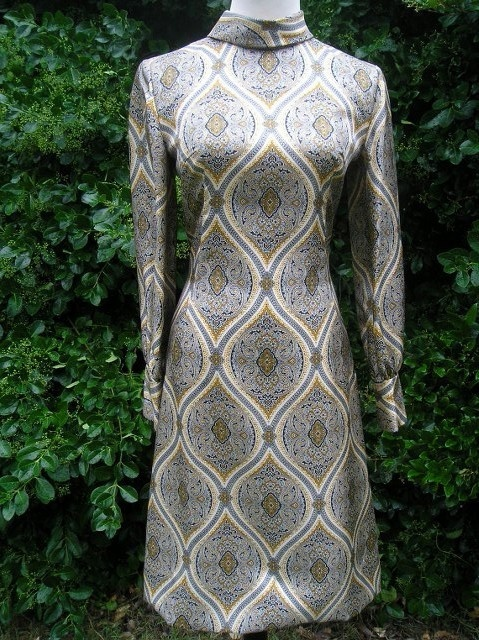 possibly a Joanie Dress...  with a pin/brooch