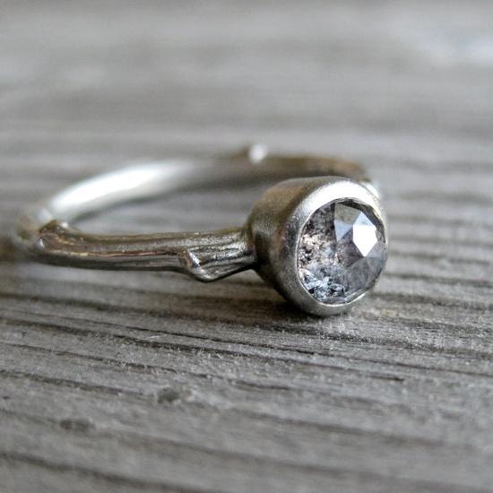 Grey diamond ring. LOVE the black flecks inside of it.
