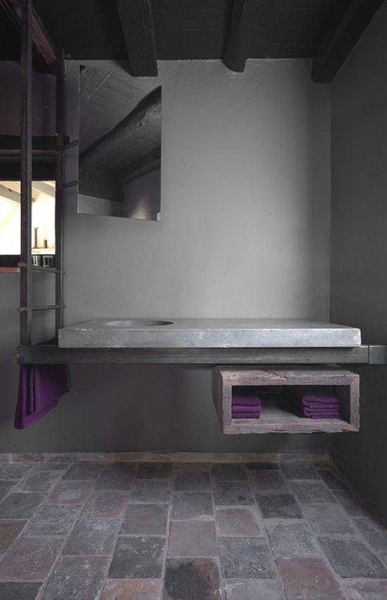 Bathroom interior by Dirk Cousaert. Blue stone + iron + oak.
