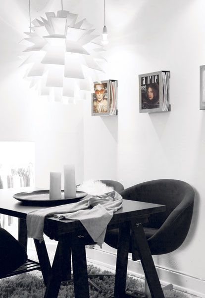 Modern black n' white interior with magazines on The wall. Love The idea!