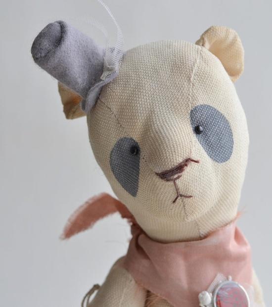 Bear in a gray hat