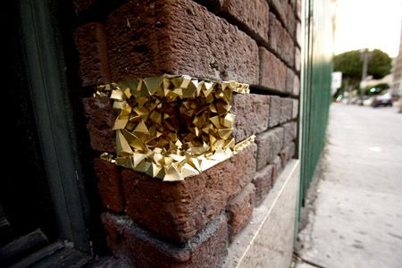 """GEODE"" STREET ART PROJECT: These  3D paper sculptures come in all sizes and fit in the holes of buildings."