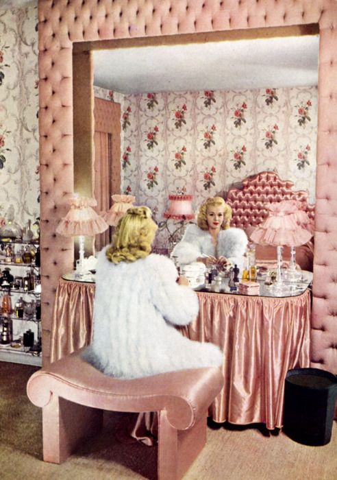 One of the most delightfully pretty vintage bedrooms and vanity tables imaginable. #vintage #pink #1940s #bedroom #pink #home #decor #vanity #table #makeup #cosmetics