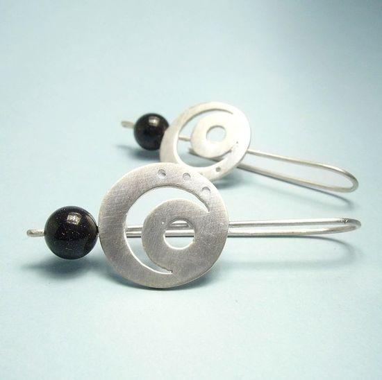 Hand cut earrings in  sterling silver moon design by aforfebre