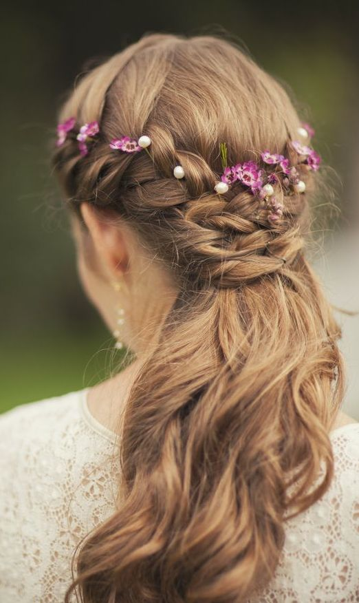 Lovely braided hair with flowers