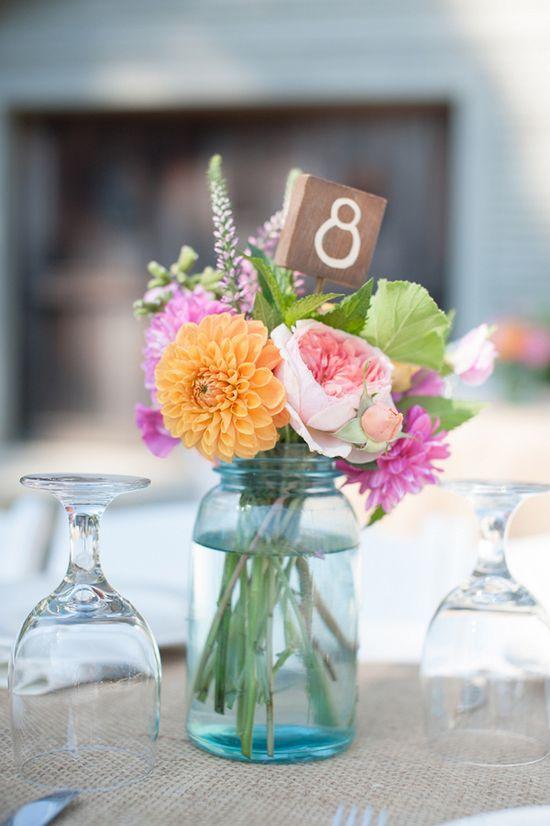 petite floral arrangement + wooden table number sign // photo by Rahel Menig // view more: ruffledblog.com/...