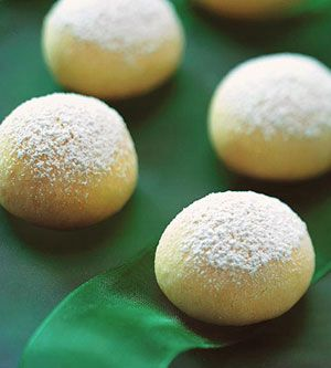 Sprinkle these buttery cookies with confectioners' sugar while still warm. The heat from the cookies melts the sugar just a little allowing it to better coat the cookies.