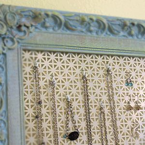 radiator cover in frame to hold jewelry