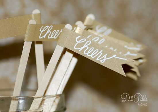 shimmery gold paper flag drink stirrers