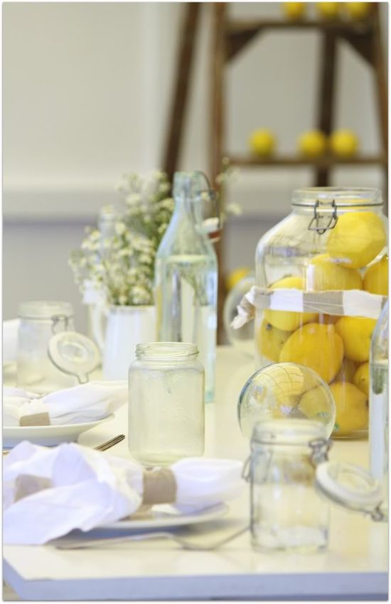 Large jar filled with lemons as centerpiece! All natural, colorful, fresh and easy table decor idea from www.shopbevel.com. Sourced from abeachcottage.com. #lemon #tablesetting #events #party #wedding #diy #farm #rustic