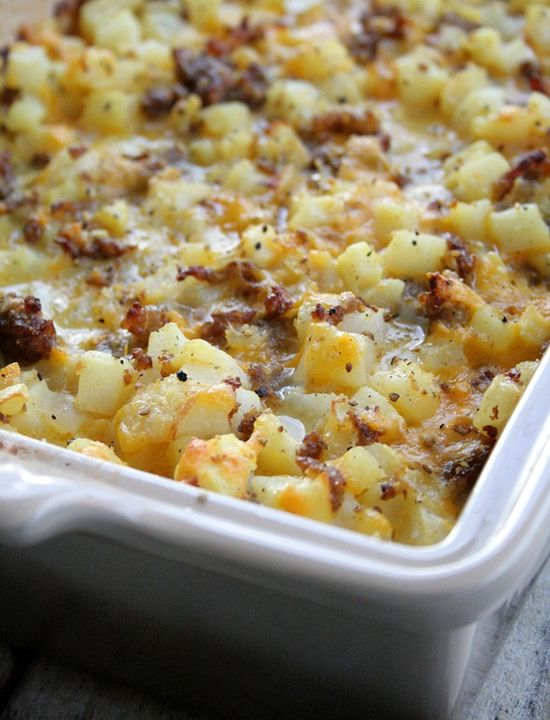 Cheesy Potato Breakfast Casserole. Hash browns, Italian sausage, and cheese - what's not to love?! Try this potato casserole recipe today.