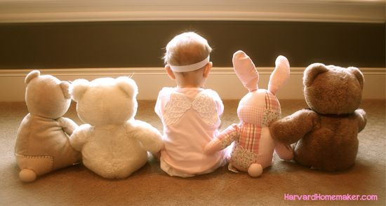 Line up your baby or little girl next to stuffed animals in front of a sunny window for a cute photo.  So sweet!