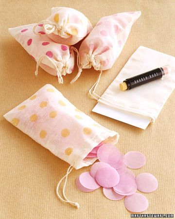 Put confetti inside bags stamped with bright polka dots for guests to throw. #MarthaStewartWeddingsMagazine