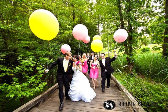 Group Photography Ideas: 20 Creative Wedding Poses for Bridal Party - a lot of these are kind of cheesy, but I do like the big helium balloons, fun and whimsical