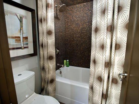Updated Bath. Love the shower curtain! www.hgtv.com/...