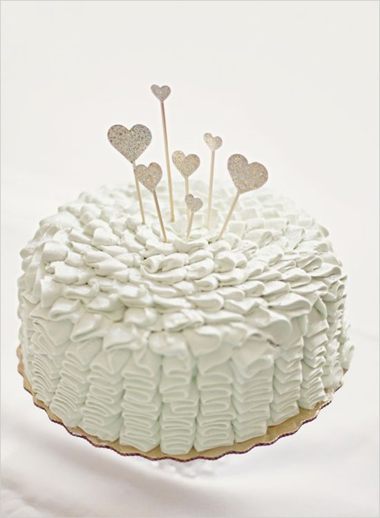 Simple ruffled wedding cake. I could see myself having a simple cake like this if I end up having a small wedding :)
