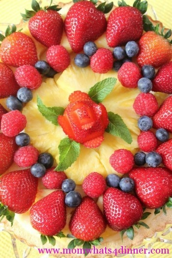 Cute strawberry flower design on a fruit tart