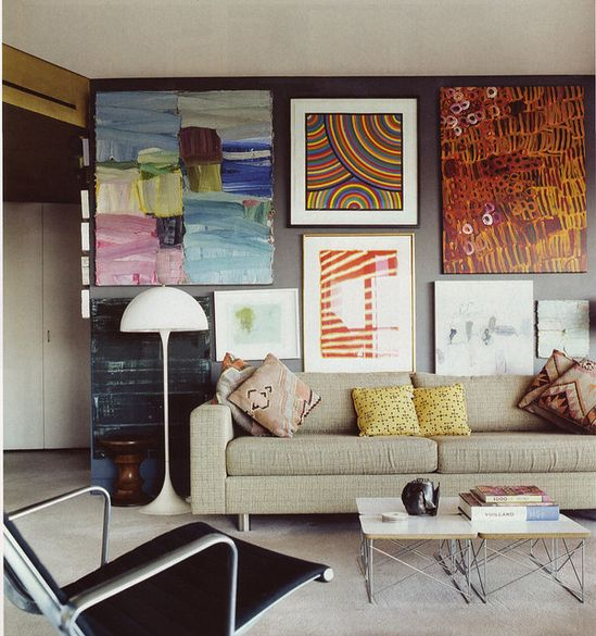 subdued furniture, colorful art.