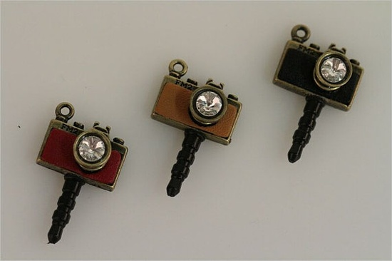 Camera Cell Phone Charm Plug. These are super cute! They plug into a smart phone's headphone jack. Keeps dust out of it as well!