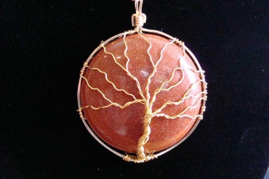 This beautiful pendant is made from a round, brown goldstone cabachon and 12K gold-filled wire. The tree itself is made from gold-colored, copper wire. MEMBER - Wire-Wrapped Jewelry by Kristine Gulick