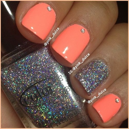 rhinestones with glitter nail polish and peach nails.