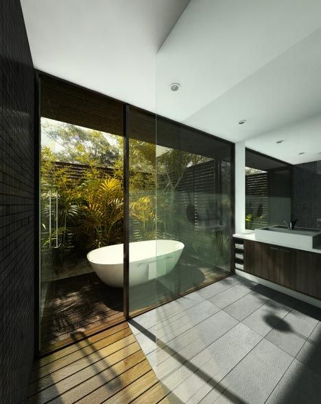 Naturally Rustic: these images depict delightful nature-integrated bathroom designs that are uncompromising modern their modern minimalism when it comes to the materials, surfaces and fixtures. Nonetheless, by tapping into the outdoors around them that modernism is softened by the surrounding environment (Images via Evan Mandala and Kim Stapleton).
