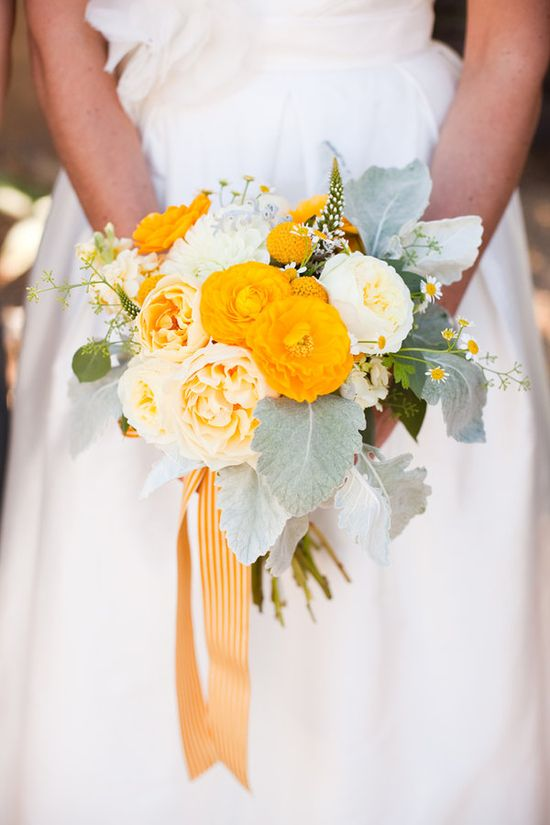 yellow ranunculus, garden rose, chamomile and dusty miller bouquet