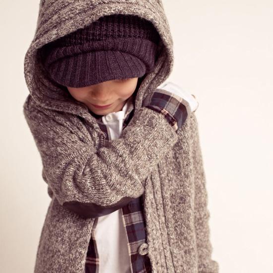 super cute kid...love the cardigan