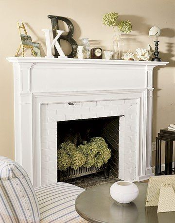 Flower arrangement in fireplace