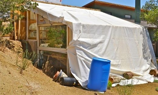 Same green house plan built into a hill, shade cloth for summer