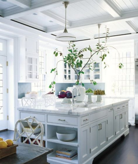 White ceiling, love this island too. And Loop chairs with antique wood table.