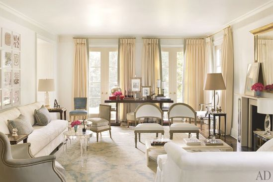 Decorator Suzanne Kasler renovated her Regency-style house in Atlanta with a soothing color palette. The acrylic tables are by Nancy Corzine
