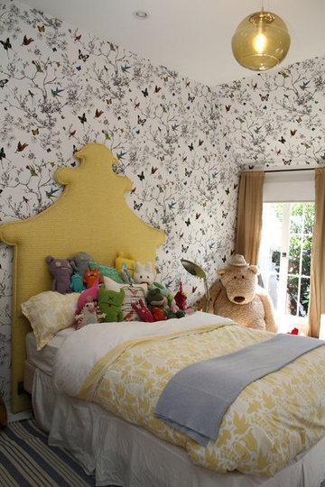 yellow pagoda headboard and butterfly wallpaper