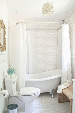 I am determined to have a clawfoot tub someday...and that light fixture...