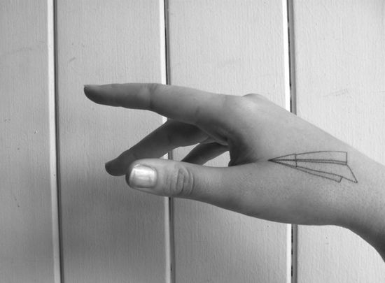 Love: paper airplane temporary tattoo.