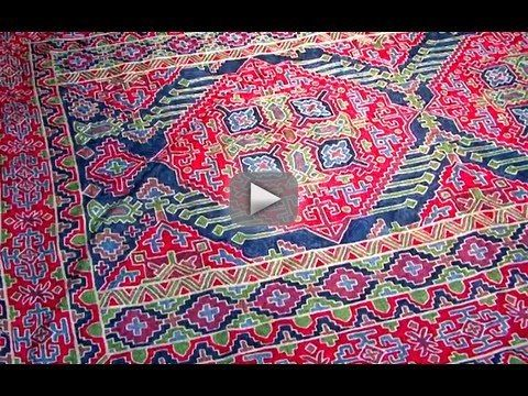 Kashmiri Handmade Rug Designs - Old Delhi India - After we learned all there was to learn about pashmina, Farooq also gave us a quick tour through the different Kashmiri traditional rug designs. The hand