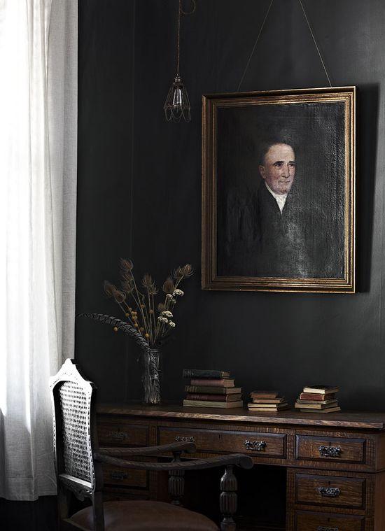 portraits on dark wall