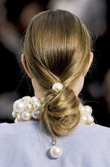 Oversized pearls + low bun