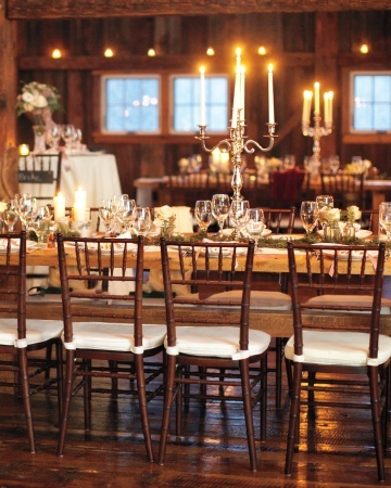 Scores of candles -- votives, pillars, and tapers -- cast a glow over king-sized tables