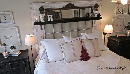 Love the old window used for a headboard....they should lose the shelf or paint it white..maybe add black and white pillows to tie the black night stands in....
