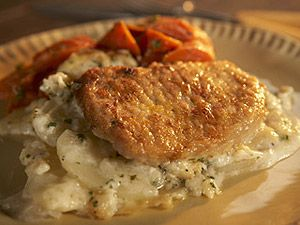 Potatoes, onions, and pork chops in a delicious white sauce.