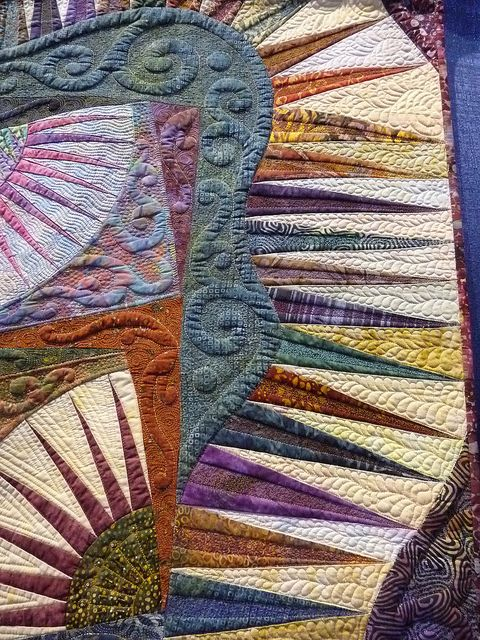 I made a Karen Stone New York Beauty several years ago. The image is similar to mine. Lots of piecing but the quilt is paper pieced so the points and pattern go together very well. (NL)