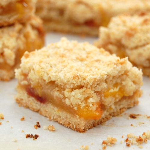 Peach Crumb Bars by sweetpeaskitchen #Bars #Peach
