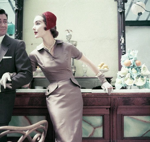 So very, very chic (and her arm candy isn't too shabby either!). #vintage #dress #hat #gloves #1950s #fashion