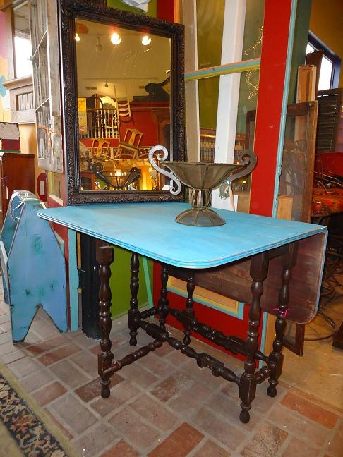 Take function to fabulous by adding a touch of color in this practical folddown table with spiral legs.