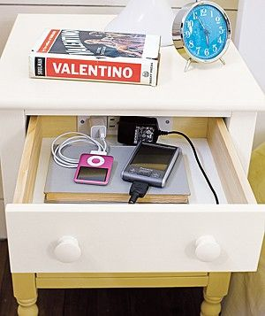 Bedside table features a three-plug outlet in the top drawer