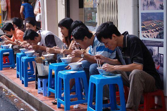 enjoying street food in Vietnam