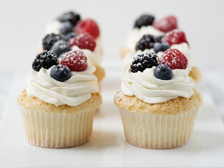 Angel Food Cupcakes with Whipped Cream and Berries Make angel food cake in cupcake form and top with fresh berries and vanilla-bean whipped cream and you will have a heavenly little dessert.